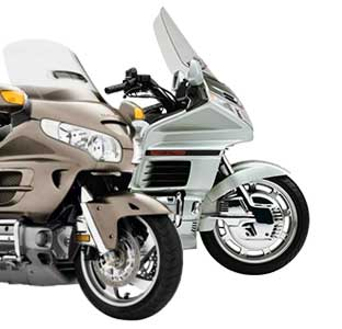 Photo of a green GL-1500 and tan GL-1800 Honda Gold Wing motorcycles