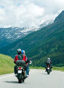 Photo of motorcycle riders enjoying a mountain ride