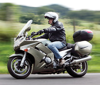 photo of solo Kawasaki motorcycle rider